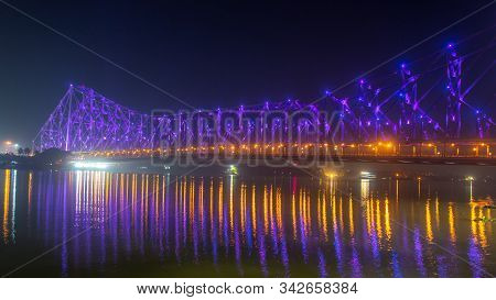 Howrah Bridge (selective Focus) - The Historic Cantilever Bridge On The River Hooghly Lit With Purpl