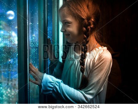 Emotional Portrait Of A Girl At The Window