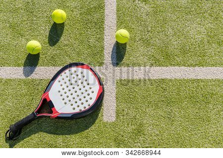 Top View Of A Paddle Tennis Racket And Balls On Court Of Artificial Turf, Indoor Sports Concept And