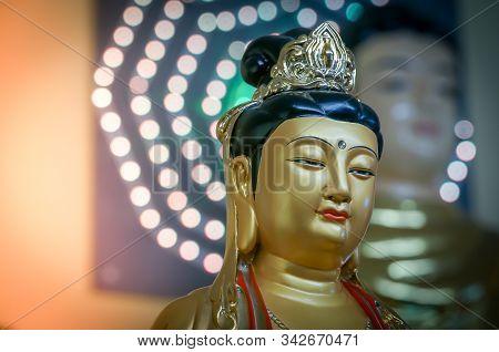 Golden Statue Of Buddha Bodhisattva Guanyin Or Kuan Yin (avalokiteshvara) In A Buddhist Pagoda Templ