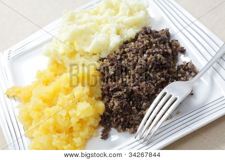 A traditional Scottish haggis meal, often served on Burns' Night, with mashed potatoes and swede also known as