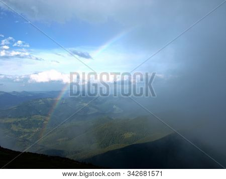 Rainbow Between The Land And Clouds High In Carpathian Mountains.  Heaven Kitchen Prepares Rainy Whe