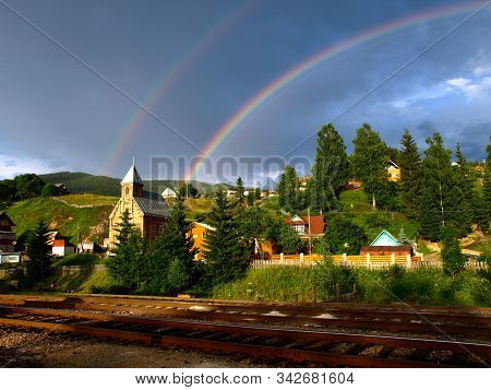 Twin Rainbow Over Carpathian Mountain Village. Picturesque And Magic Carpathian Mountains In Summer.