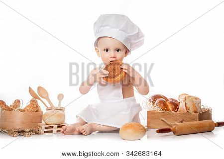 Little Baby Boy Baker Enjoying Making And Eating Food. Little Baker.