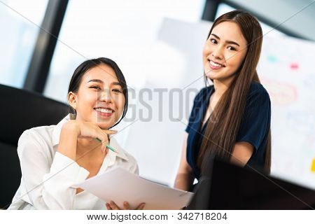 Portrait Of Two Beautiful Asian Office Coworkers Smiling Together At Work. Business Colleagues, Team