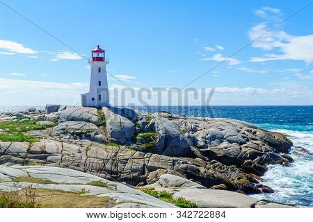View Of The Lighthouse Of The Fishing Village Peggys Cove, In Nova Scotia, Canada
