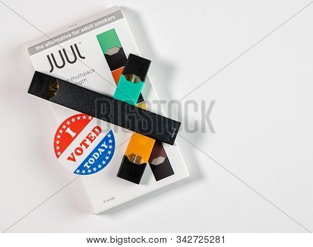 Morgantown, Wv - 2 January 2020: Juul Flavored Nicotine Vaping System With I Voted Sticker To Illust