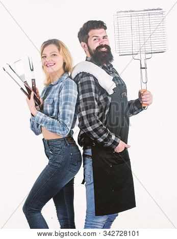Grill And Grate Gripper Tools. Family Having Barbecue Party. Bearded Hipster And Sensual Woman Holdi
