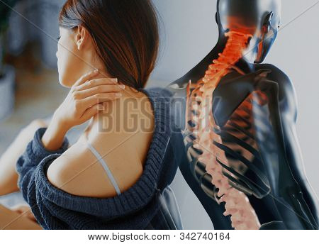 Close Up Of A Brunette Woman Massaging Her Neck In A Bedroom