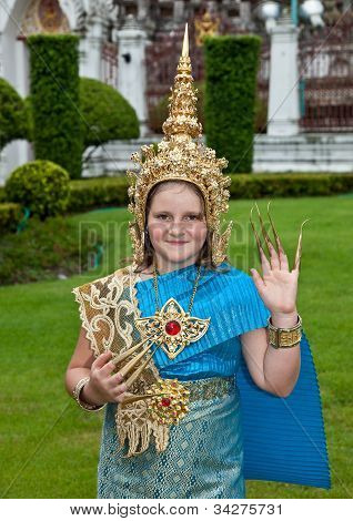 Young  girl tourist in Thai dance costume