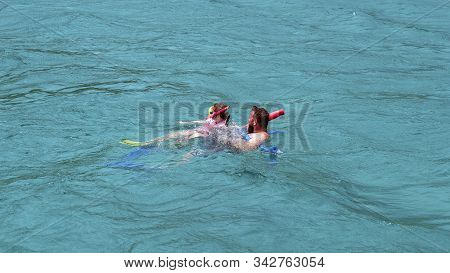 Yeppoon, Queensland, Australia - December 2019: Father And Daughter Snorkeling In The Waters Over A