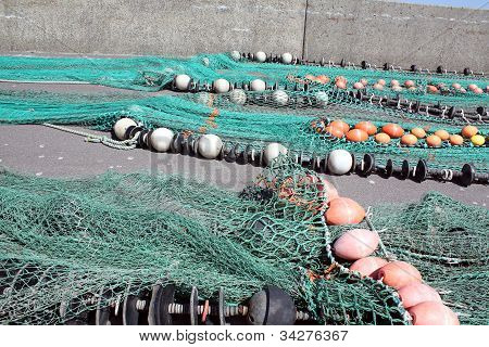 Fishing nets are drying in a port on Bornholm in Denmark poster