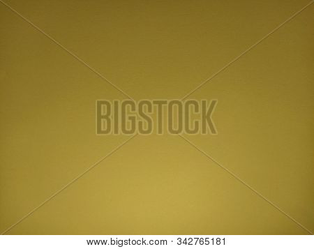 Yellow Or Ocher Horizontal Background. A Dist Of Colored Paper, Dimly Lit From Below. The Play Of Li