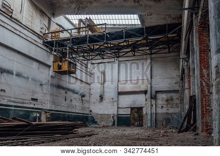 Old Abandoned Factory Interior. Empty Ruined Workshop