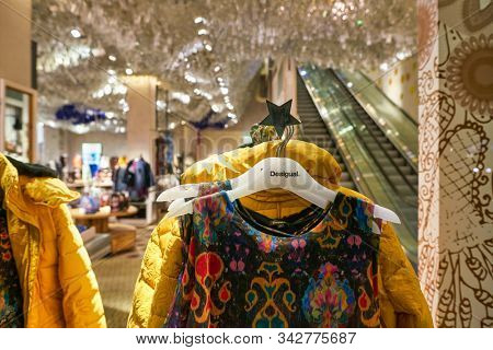 BERLIN, GERMANY - CIRCA SEPTEMBER, 2019: clothes on display at Desigual store in Berlin.