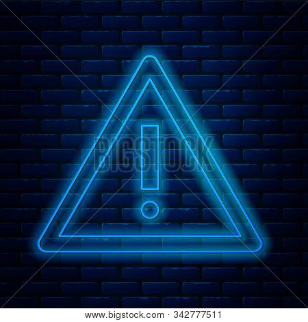 Glowing Neon Line Exclamation Mark In Triangle Icon Isolated On Brick Wall Background. Hazard Warnin