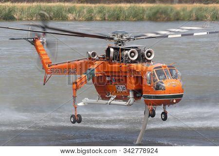 Bundoora, Australia - December 30, 2019: Erickson Air Crane Helicopter N243ac (sikorsky S-64e) Sucki