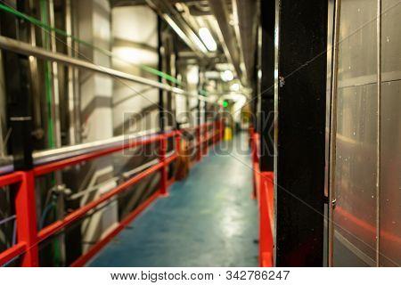 Passageway Between Metal Tanks, Vessels And Pipes, Modern Brewhouse Brewery Beer Factory Industrial