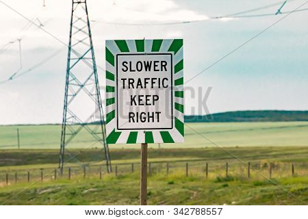 Slow Traffic On Multi-lane Roads Must Keep Right. Regulatory Road Sign With White And Green Lines Fr