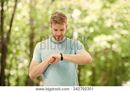 Smart Fitness. Fit Athlete Tracking His Fitness Activity With Sports Watch. Handsome Athlete Using F