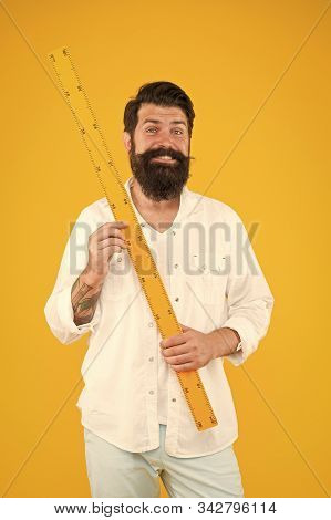Man Bearded Hipster Holding Ruler. Measure Length. Size Tall And Length. Big Size. Measure. Geometry