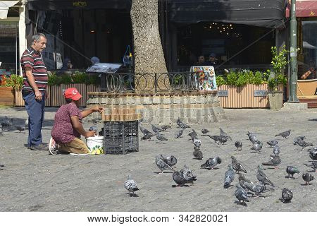Istanbul, Turkey - September 10th 2019. A Street Vendor Sells Bird Seed To Passersby To Feed Pigeons