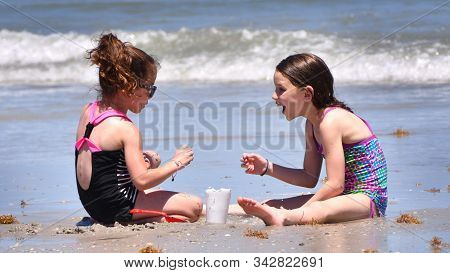 Florida,united States,may 2019,two Girl Child Playing In Beach At Florida