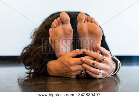 A Close Up And Front View On The Dirty Bare Feet Of A Healthy Lady In An Intense Dorsal Stretch Pose