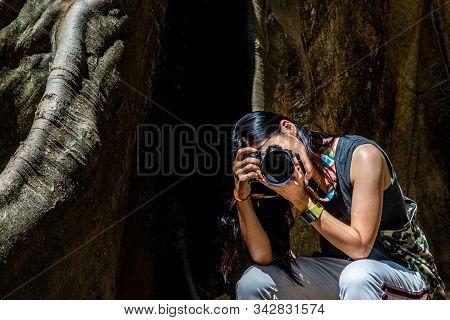 Bangkok, Thailand - 15 Dec 2019 : Young Woman With Shoulder Bag And Using A Camera To Take Photo Gia