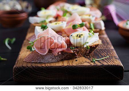 Bruschetta With Prosciutto/jamon Traditional Italian Antipasto. Delicious Snack With Bread, Brie Che