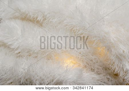 Fluffy And Fleecy Warm Fabric. Light Fabric With Lights Between The Folds. Abstract Background. Sele