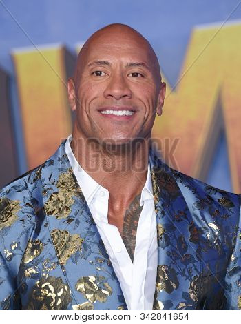 LOS ANGELES - DEC 09:  Dwayne Johnson arrives for the ÔJumanji: The Next LevelÕ Los Angeles Premiere on December 09, 2019 in Hollywood, CA