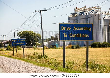 French, English Information Road Signs, Drive According To Conditions. Canadian Rural Country Roadsi