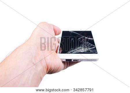Mans Hand Holds A Phone With A Broken Screen.