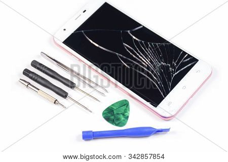 Cell Phone With A Broken Screen On A White Background.