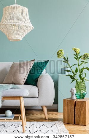 Modern Scandinavian Home Interior Of Living Room With Gray Sofa, Wooden Cube, Flowers In Vase, Sculp