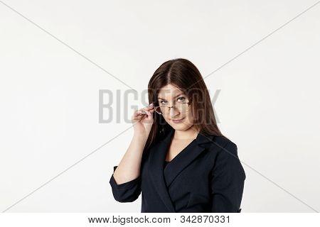 Young Woman Looking At Camera Through Glasses.
