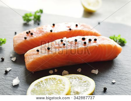 Delicious Raw Salmon Fillet Or Sashimi On A Slate Plate. Fresh Salmon And Cooking Ingredients. Close