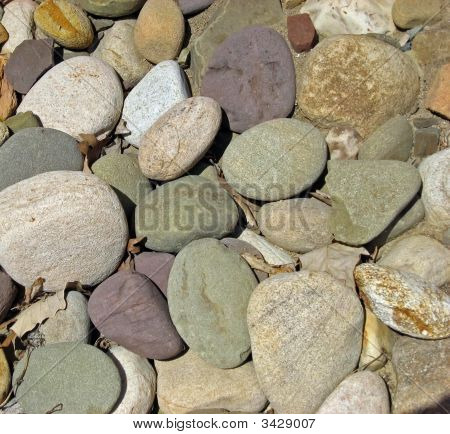 Multi-colored rocks and stones used in landscaping. poster