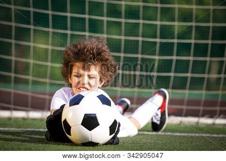 Young Soccer Goalie Attempting To Make A Save. Little Soccer Goalkeeper With Gloves. Kids - Soccer C