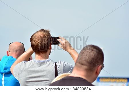 Plane Spotters Taking Photo Of An Airplane Landing. Aircraft Or Plane Spotting Is A Hobby Of Trackin