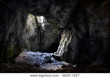 Entrance to the Jaskinia Raptawicka cave in Polish Tatra Mountains