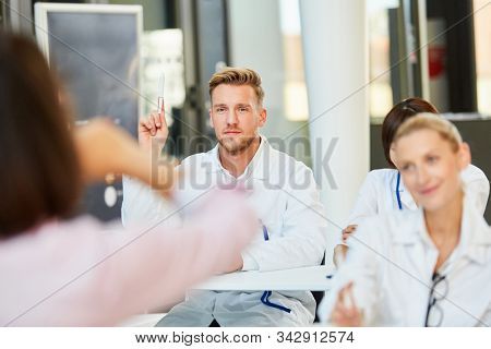Young medicine student or doctor answers a question in a medicine lecture