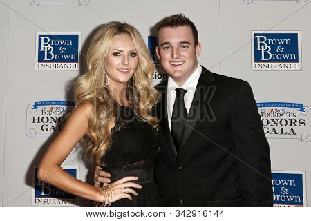 NEW YORK - SEPTEMBER 27: Ty Dillon (R) and wife Haley Carey attend the 2016 NASCAR Foundation Honors Gala at Marriott Marquis on September 27, 2016 in New York City.