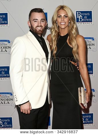 NEW YORK - SEPTEMBER 27: Austin Dillon (L) and wife Whitney attend the 2016 NASCAR Foundation Honors Gala at Marriott Marquis on September 27, 2016 in New York City.