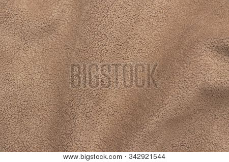 Background Texture Of Faux Suede Closeup. Faux Brown Suede Beautifully By The Waves.