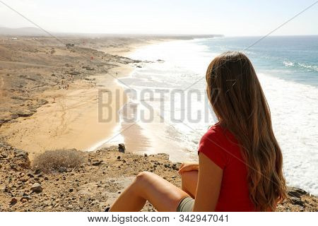 Calm, Relax ,mind Reset Concept. Young Woman Sitting On Top Of The Cliff, Breathing Fresh Air And En