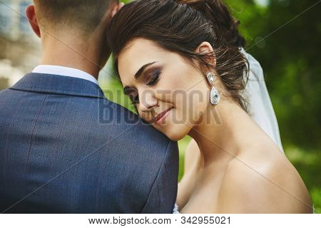 Portrait Of Beautiful Plus Size Model Woman With Stylish Wedding Hairstyle In A Fashionable Dress Le
