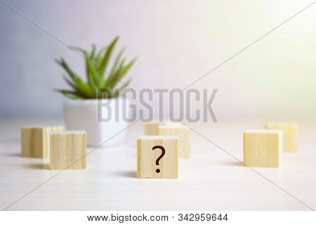 Questions Mark Word With Wooden Cube Block On Table Background. Faq Frequency Asked Questions , Answ