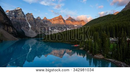 Beautiful Panoramic View Of An Iconic Famous Place, Moraine Lake, During A Vibrant Summer Sunrise. L